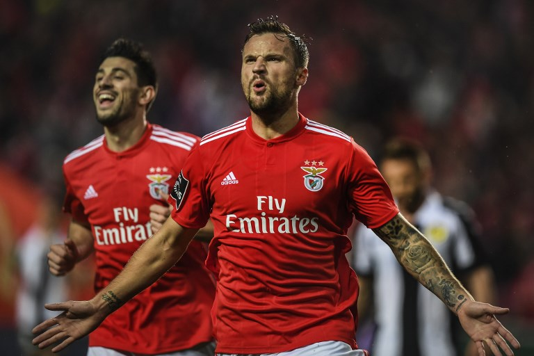 Benfica's Swiss forward Haris Seferovic (R) celebrates with his teammate Benfica's midfielder Pizzi Fernandes (L) after scoring during the Portuguese League football match between SL Benfica and CD Nacional at the Luz stadium in Lisbon on February 10, 2019. PHOTO/AFP
