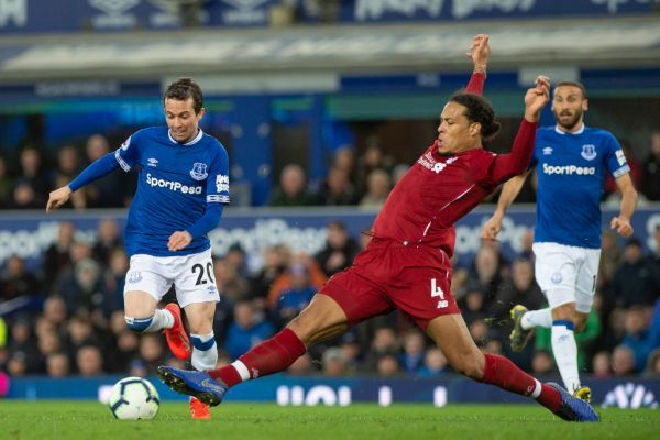 Bernard of Everton FC is tackled by Virgil van Dijk of Liverpool during the Premier League match between Everton and Liverpool at Goodison Park, Liverpool on Sunday 3rd March 2019. PHOTO | AFP
