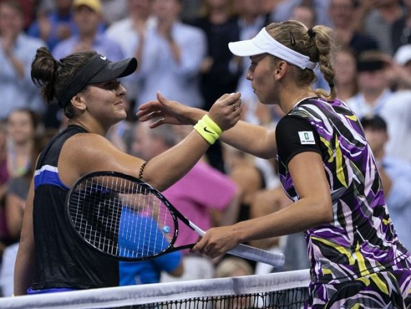Bianca Andreescu (L) of Canada and Elise Mertens of Belgium meet at the net after their Quarter-finals Women's Singles match at the 2019 US Open at the USTA Billie Jean King National Tennis Center in New York on September 4, 2019. PHOTO | AFP