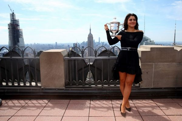 Bianca Andreescu of Canada poses with her trophy at the Top of the Rock in Rockefeller Center on September 8, 2019 in New York City. PHOTO | AFP