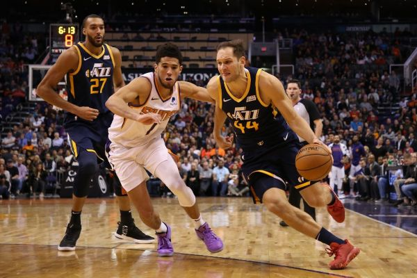 Bojan Bogdanovic #44 of the Utah Jazz drives the ball past Devin Booker #1 of the Phoenix Suns during the second half of the NBA game at Talking Stick Resort Arena on October 28, 2019 in Phoenix, Arizona. The Jazz defeated the Suns 96-95. PHOTO   AFP