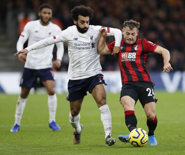 Bournemouth's Scottish midfielder Ryan Fraser (R) holds off Liverpool's Egyptian midfielder Mohamed Salah (L) to play the ball during the English Premier League football match between Bournemouth and Liverpool at the Vitality Stadium in Bournemouth, southern England on December 7, 2019. PHOTO | AFP