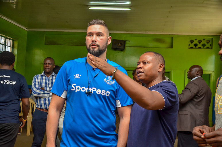 Boxing promoter Thomas Mutua Kiswili (right) shows retired WBC champion Tony Bellew around the Pal Pal Gym in Nairobi on March 21, 2019. PHOTO/SPN