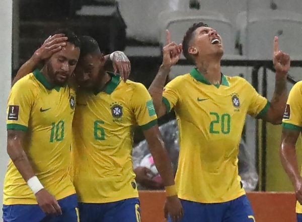 Brazil's Roberto Firmino (R) celebrates next to teammates Neymar (L) and Renan Lodi after scoring against Bolivia during their 2022 FIFA World Cup South American qualifier football match at the Neo Quimica Arena, also known as Itaquerao, in Sao Paulo, Brazil, on October 9, 2020, amid the COVID-19 novel coronavirus pandemic. PHOTO   AFP