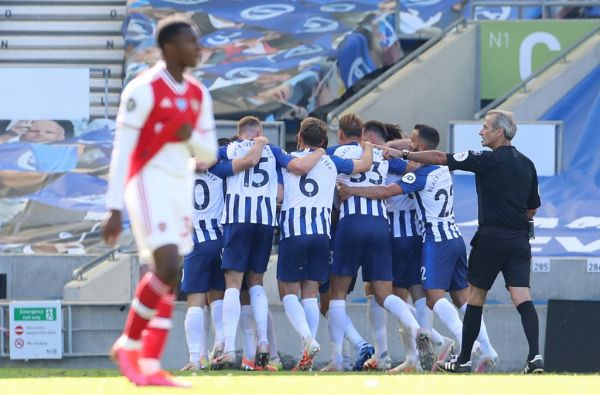 Brighton's French striker Neal Maupay (unseen) celebrates with teammates after scoring his team's second goal during the English Premier League football match between Brighton and Hove Albion and Arsenal at the American Express Community Stadium in Brighton, southern England on June 20, 2020. PHOTO | AFP