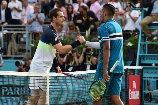 Britain's Andy Murray (L) shakes hands with Australia's Nick Kyrgio after the first round men's singles match at the ATP Queen's Club Championships tennis tournament in west London on June 19, 2018. Britain's Andy Murray was beaten 2-6, 7-6 (7/4), 7-5 by Australian Nick Kyrgios in the Queen's Club first round. PHOTO | AFP