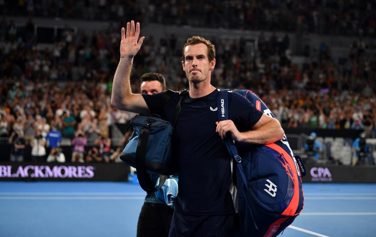 Britain's Andy Murray waves to supporters after his defeat against Spain's Roberto Bautista Agut during their men's singles match on day one of the Australian Open tennis tournament in Melbourne on January 14, 2019. PHOTO/AFP