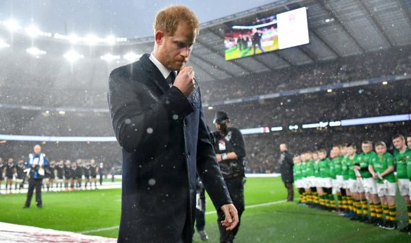 Britain's Prince Harry, Duke of Sussex, returns after laying a wreath on the pitch ahead of the autumn international rugby union match between England and New Zealand at Twickenham stadium in south-west London on November 10, 2018, to mark Armistice Day, and the 100th anniversay of the enfd of WWI. PHOTO | AFP