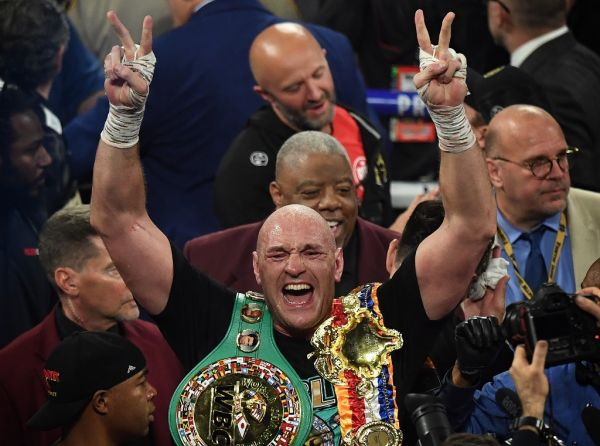 British boxer Tyson Fury celebrates after defeating US boxer Deontay Wilder in the seventh round during their World Boxing Council (WBC) Heavyweight Championship Title boxing match at the MGM Grand Garden Arena in Las Vegas on February 22, 2020. PHOTO | AFP