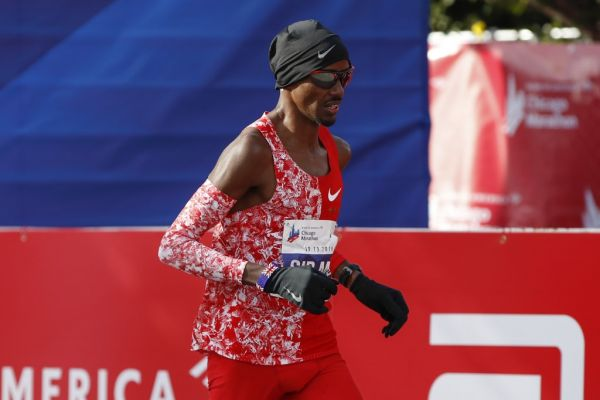 British distance runner Mo Farah crosses the finish line during the 2019 Bank of America Chicago Marathon on October 13, 2019 in Chicago, Illinois. Kenya's Lawrence Cherono won a men's race that came down to the wire in 2:05:45 -- barely edging Ethiopia's Dejene Debela who was second in 2:05:46 with another Ethiopian, Asefa Mengstu, third in 2:05:48. Last year's winner Mo Farah of Britain was never a factor -- finishing a distant eighth in 2:09:58. PHOTO | AFP