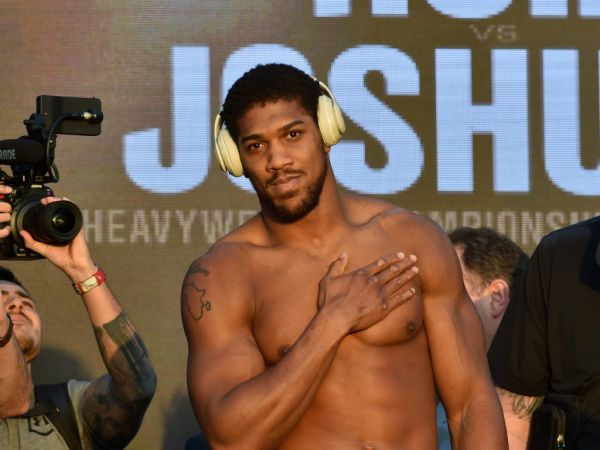 "British heavyweight boxing challenger Anthony Joshua gestures during his official weigh-in in the Saudi capital Riyadh, on December 6, 2019, ahead of the upcoming ""Clash on the Dunes"". The hotly-anticipated rematch between Ruiz Jr and British challenger Anthony Joshua is scheduled to take place in Diriya, near the Saudi capital on December 7. PHOTO 
