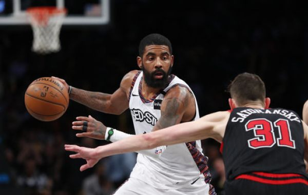 Brooklyn Nets guard Kyrie Irving (11) moves to the basket against Chicago Bulls guard Tomas Satoransky (31) during the second half at Barclays Center. PHOTO | PA Images