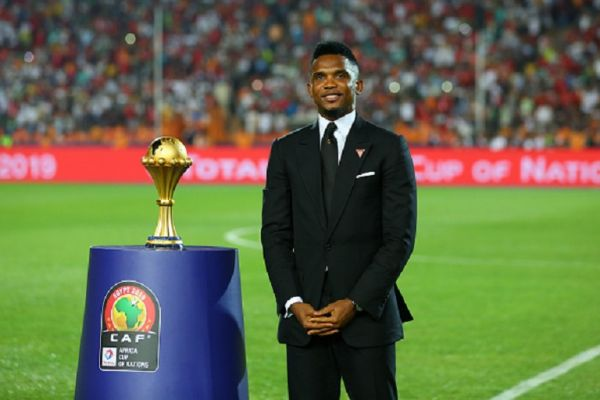 Cameroonian former footballer Samuel Eto'o holds the Africa Cup of Nations trophy prior to the start of the Africa Cup of Nations final soccer match between Senegal and Algeria at the Cairo Stadium. PHOTO/ GETTY IMAGES