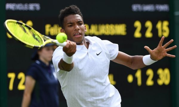 Canada's Felix Auger-Aliassime returns against Canada's Vasek Pospisil during their men's singles first round match on the first day of the 2019 Wimbledon Championships at The All England Lawn Tennis Club in Wimbledon, southwest London, on July 1, 2019. PHOTO/AFP