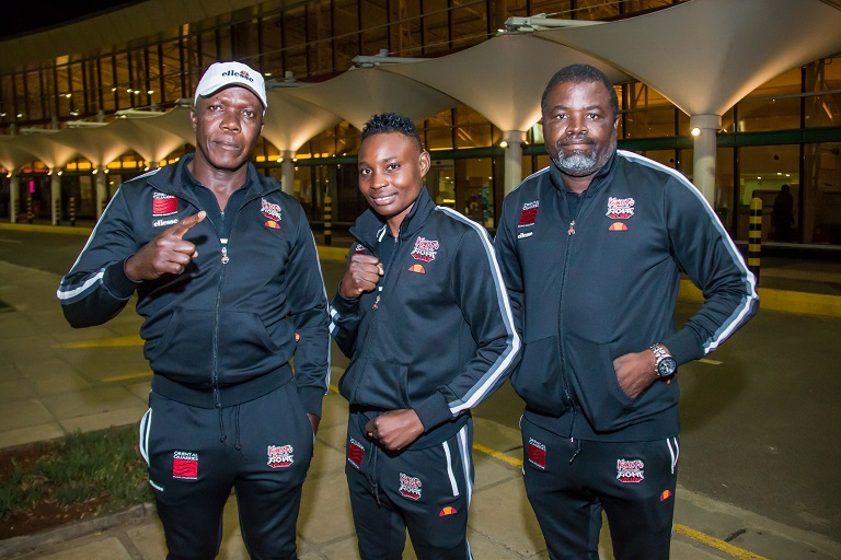 Catherine Phiri (middle) poses with her trainer Michael Zulu (right) and promoter Christopher Malunga (left) soon after arriving at the Jomo Kenyatta International Airport on Tuesday, March 19, 2019. PHOTO/BrianKinyanjui/SPN
