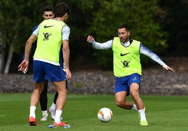 Chelsea's Belgian midfielder Eden Hazard (R) takes part in a training session at Chelsea Training Ground, in Cobham, Surrey on May 22, 2019, ahead of their Europa League final football match against Arsenal on May 29. PHOTO | AFP