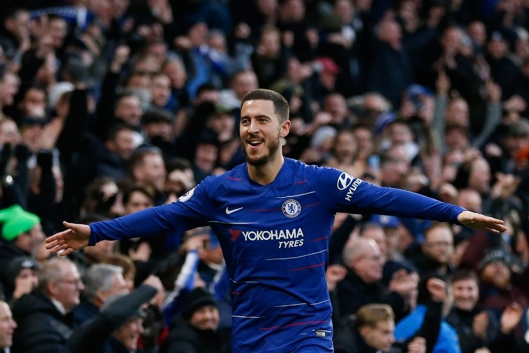Chelsea's Belgian midfielder Eden Hazard celebrates scoring their third goal during the English Premier League football match between Chelsea and Huddersfield Town at Stamford Bridge in London on February 2, 2019. PHOTO/AFP