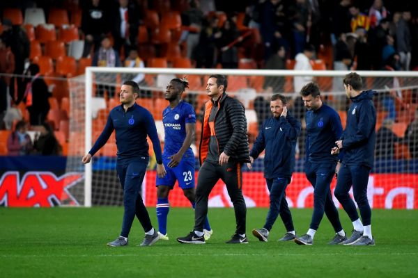 Chelsea's English head coach Frank Lampard (C) and players leave the pitch at the end of the UEFA Champions League Group H football match between Valencia CF and Chelsea FC at the Mestalla stadium in Valencia on November 27, 2019. PHOTO | AFP