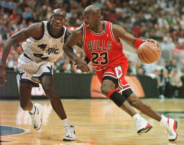 Chicago Bulls guard Michael Jordan drives past Orlando Magic forward Charles Outlaw for two points during the first period of the game at the Arena in Orlando, 25 March. PHOTO | AFP
