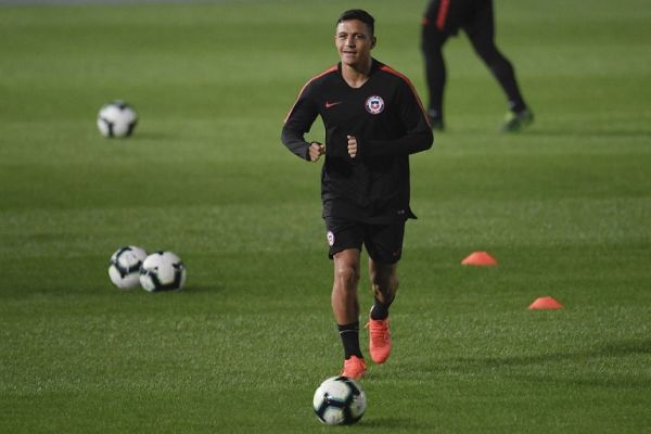 Chile's player Alexis Sanchez smiles as he runs for the ball during a practice session at the Nilton Santos stadium in Rio de Janeiro, Brazil, on June 23, 2019, on the eve of the Copa America football match against Uruguay. PHOTO | AFP