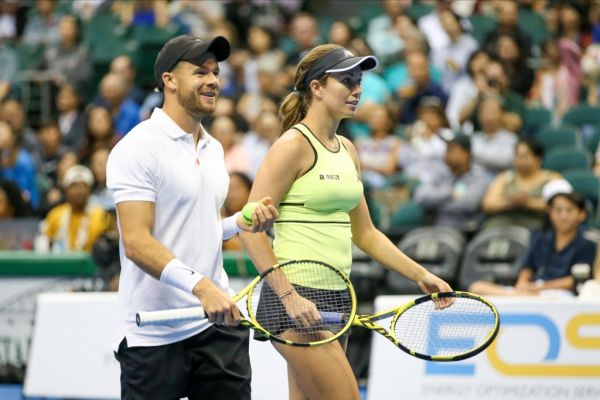 Christian Harrison of the United States and Danielle Collins of the United Statesenjoy the moment during a mixed-doubles exhibition match at the Hawaii Tennis Open against Sam Querrey of the Unites States and Yanina Wickmayer of Belgium at the Stan Sheriff Center on December 28, 2019 in Honolulu, Hawaii. PHOTO | AFP