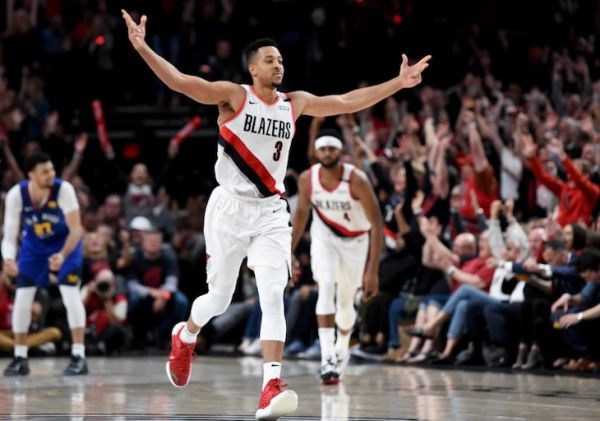 CJ McCollum #3 of the Portland Trail Blazers reacts to hitting a shot during the second half of game three of the Western Conference Semifinals against the Denver Nuggets at Moda Center on May 03, 2019 in Portland, Oregon. The Blazers won 140-137 in 4 overtimes. PHOTO/AFP
