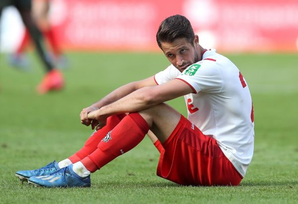 Cologne's Mark Uth sits on the grass after the game. PHOTO | AFP