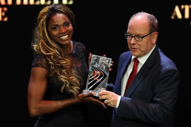 Colombia's athlete Caterine Ibarguen receives the Female athlete of the year award from Prince Albert II of Monaco (R) during the IAAF athlete of the year awards ceremony, on December 4, 2018 in Monaco. PHOTO/AFP
