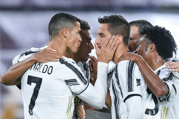 Cristiano Ronaldo of Juventus FC celebrates with Rodrigo Bentancur of Juventus FC scoring second goal during the Serie A match between AS Roma and Juventus FC at Stadio Olimpico, Rome, Italy on 27 September 2020. PHOTO | AFP
