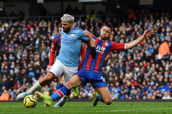 Crystal Palace's English defender Gary Cahill (R) tackles Manchester City's Argentinian striker Sergio Aguero during the English Premier League football match between Manchester City and Crystal Palace at the Etihad Stadium in Manchester, north west England, on January 18, 2020. PHOTO | AFP