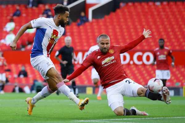 Crystal Palace's English midfielder Andros Townsend (L) shoots to score the opening goal as Manchester United's English defender Luke Shaw (R) tries to block during the English Premier League football match between Manchester United and Crystal Palace at Old Trafford in Manchester, north west England, on September 19, 2020. PHOTO | AFP