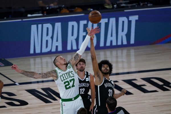 Daniel Theis #27 of the Boston Celtics and Jarrett Allen #31 of the Brooklyn Nets battle for the opening tip-off at The Arena at ESPN Wide World Of Sports Complex on August 5, 2020 in Lake Buena Vista, Florida. PHOTO | AFP