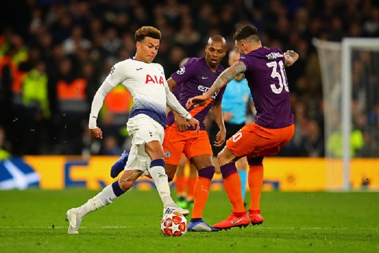 Dele Alli of Tottenham Hotspur in action with Nicolas Otamendi of Manchester City during the UEFA Champions League Quarter Final first leg match between Tottenham Hotspur and Manchester City at Tottenham Hotspur Stadium on April 09, 2019 in London, England. PHOTO/GETTY IMAGES