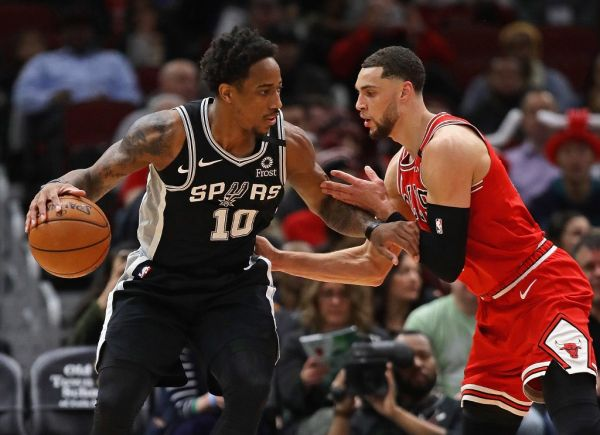 DeMar DeRozan #10 of the San Antonio Spurs moves against Zach LaVine #8 of the Chicago Bulls at the United Center on January 27, 2020 in Chicago, Illinois. PHOTO | AFP