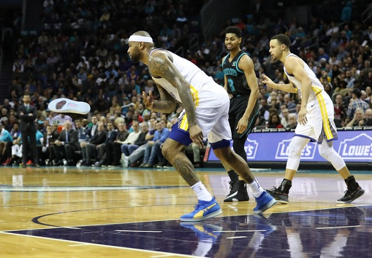 DeMarcus Cousins #0 of the Golden State Warriors throws the shoe of Jeremy Lamb #3 of the Charlotte Hornets off the court during their game at Spectrum Center on February 25, 2019 in Charlotte, North Carolina. PHOTO/AFP