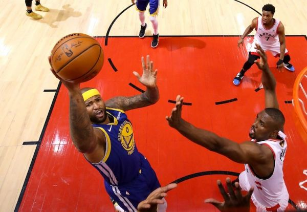 DeMarcus Cousins of the Golden State Warriors attempts a shot over Serge Ibaka of the Toronto Raptors during Game Five of the 2019 NBA Finals at Scotiabank Arena on June 10, 2019 in Toronto, Canada. PHOTO/AFP