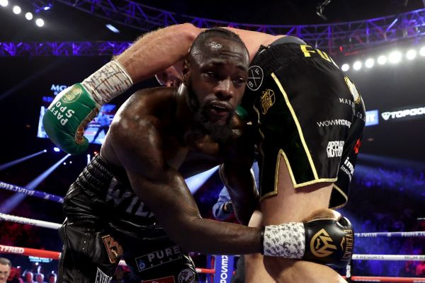 Deontay Wilder (L) grabs Tyson Fury during their Heavyweight bout for Wilder's WBC and Fury's lineal heavyweight title on February 22, 2020 at MGM Grand Garden Arena in Las Vegas, Nevada. PHOTO | AFP