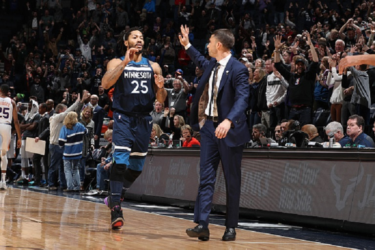 Derrick Rose #25 of the Minnesota Timberwolves high-fives Ryan Saunders of the Minnesota Timberwolves after hitting game winning shot against the Phoenix Suns on January 20, 2019 at Target Center in Minneapolis, Minnesota. PHOTO/GettyImages