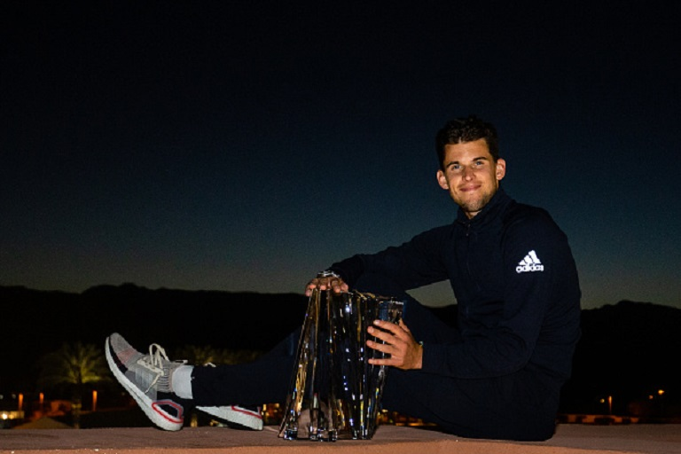 Dominic Thiem of Austria poses with the winner's trophy after defeating Roger Federer of Switzerland in the men's singles final on Day 14 of the BNP Paribas Open at the Indian Wells Tennis Garden on March 17, 2019 in Indian Wells, California. PHOTO/ GETTY IMAGES