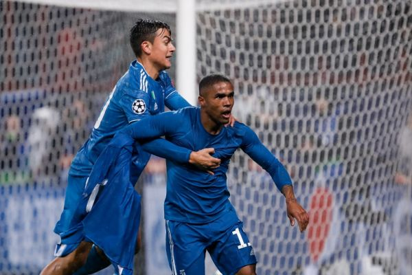 Douglas Costa (R) of Juventus celebrates his goal with Paulo Dybala during the UEFA Champions League Group D match between Lokomotiv Moskva and Juventus FC on November 6, 2019 at RZD Arena in Moscow, Russia. PHOTO | AFP