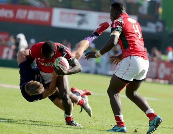 Eden Agero (C) of Kenya holds the ball during the Men's Sevens World Rugby Dubai Series match Scotland vs Kenya on November 30, 2018 in Dubai. PHOTO | AFP