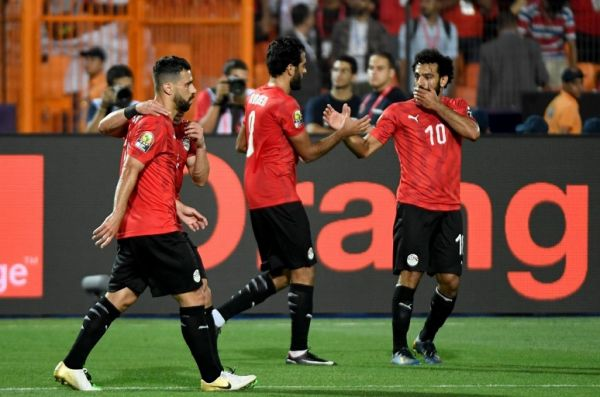 Egypt's forward Marwan Mohsen (C) and Egypt's forward Mohamed Salah (R) celebrate after scoring a goal during the 2019 Africa Cup of Nations (CAN) football match between Egypt and DR Congo at the Cairo International Stadium on June 26, 2019.  PHOTO   AFP