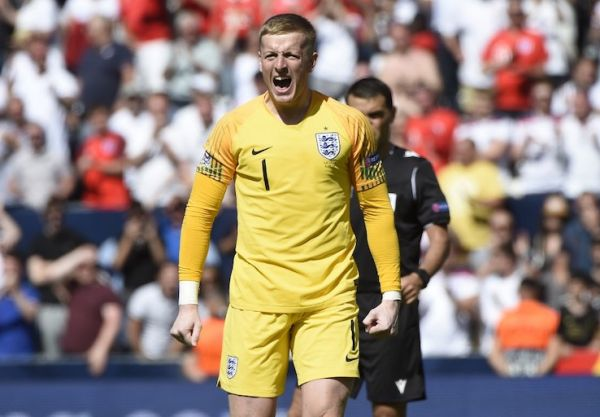 England's goalkeeper Jordan Pickford celebrates a goal during the penalty shootout during the UEFA Nations League third place football match between England and Switzerland at the D.Afonso Henriques stadium in Guimaraes, on June 9, 2019. PHOTO/AFP