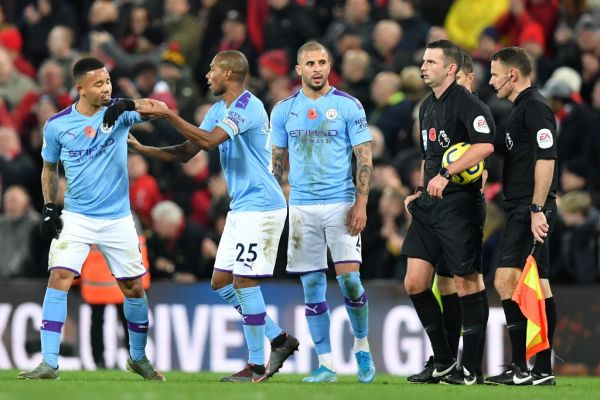 English referee Michael Oliver and his officials stand with Manchester City's Brazilian striker Gabriel Jesus (L), Manchester City's Brazilian midfielder Fernandinho (2nd L) and Manchester City's English defender Kyle Walker (3rd L) on the pitch after the English Premier League football match between Liverpool and Manchester City at Anfield in Liverpool, north west England on November 10, 2019. Liverpool won the game 3-1. PHOTO | AFP