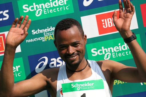 Ethiopia's Abrha Milaw celebrates his victory during the podium ceremony of Paris Marathon on April 14, 2019. PHOTO/AFP