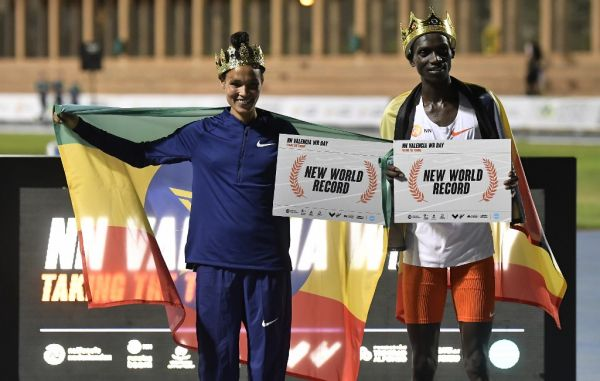 Ethiopian athlete Letesenbet Gidey (L) and Ugandan athlete Joshua Cheptegei pose after breaking the 5,000m and 10,000m track world records, respectively, during the NN Valencia World Record Day at the Turia stadium in Valencia on October 7, 2020. Joshua Cheptegei broke the 10,000m track world record with a time of 26mins 11seconds while Letesenbet Gidey set a new women's 5,000m world record of 14 minutes 6.65 seconds today in Valencia. PHOTO | AFP