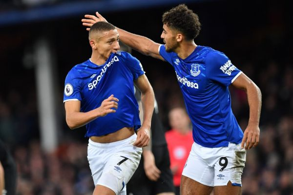 Everton's Brazilian striker Richarlison (L) celebrates with Everton's English striker Dominic Calvert-Lewin (R) after scoring the opening goal of the English Premier League football match between Everton and Brighton Hove and Albion at Goodison Park in Liverpool, north west England on January 11, 2020. PHOTO | AFP