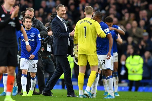 Everton's caretaker manager Duncan Ferguson (C) congratulates his players on the pitch after the English Premier League football match between Everton and Chelsea at Goodison Park in Liverpool, north west England on December 7, 2019. Everton won the game 3-1. PHOTO | AFP