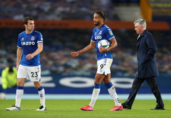 Everton's English striker Dominic Calvert-Lewin (C) walks off the pitch with the match ball after scoring a hat-trick during the English League Cup fourth round football match between Everton and West Ham United at Goodison Park in Liverpool, north west England on September 30, 2020. PHOTO | AFP