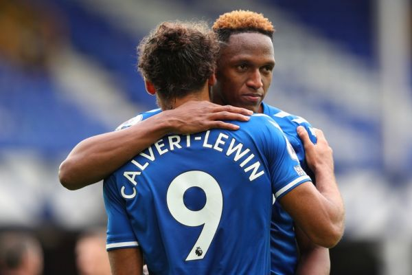 Everton's English striker Dominic Calvert-Lewin (L) and Everton's Colombian defender Yerry Mina react at the final whistle during the English Premier League football match between Everton and Liverpool at Goodison Park in Liverpool, north west England on October 17, 2020. PHOTO | AFP
